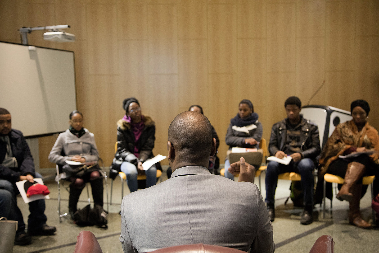 A group of people talking. Click here to go to the Professional Studies Department.